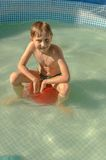 Boy swims in the pool Stock Photos