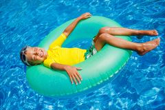 Boy swims in a pool Stock Image