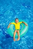Boy swims in a pool Stock Photos