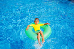 Boy swims in a pool Royalty Free Stock Images