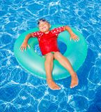 Boy swims in a pool Royalty Free Stock Image