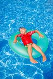 Boy swims in a pool Stock Photo