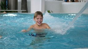 A boy swims in the pool. Relaxation and fun in the pool Royalty Free Stock Photography