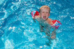 Boy swims in the pool Royalty Free Stock Photo