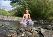 A boy swims Stock Photo