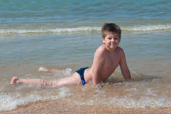 A boy swims in the sea Stock Image