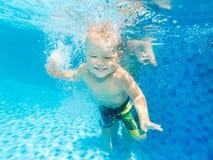 Boy swims underwater Stock Images