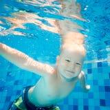 Boy swims underwater Royalty Free Stock Photo