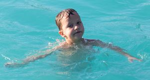Boy swims in the water park Royalty Free Stock Photos