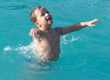 Boy swims in the water park. In the park in nature Royalty Free Stock Photo