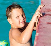 Boy swims in the water park Stock Image