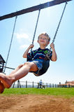 Boy on swing Stock Photos