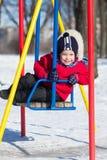 Boy on a swing Stock Image