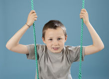 Boy on swing Royalty Free Stock Images
