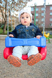 Boy swing Stock Photos