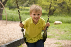Boy on Swing. 4 year old boy on a swing at a park Royalty Free Stock Images