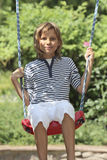Boy on a swing. Boy riding on a swing Royalty Free Stock Image