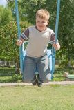 Boy on a swing Stock Photography