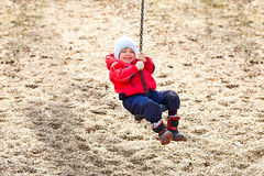 Boy at the swing. Smiling boy at the swing Stock Images