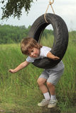 Boy on swing Royalty Free Stock Photo