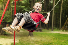 Boy on swing Stock Image