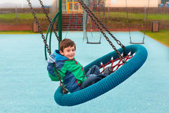 Boy on swing Royalty Free Stock Photography