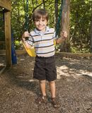 Boy on swing. Stock Photography