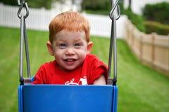 Boy on swing Stock Image