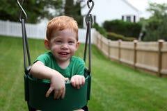 Boy on swing Stock Photography