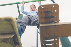 Kid taking exercise  Royalty Free Stock Photo