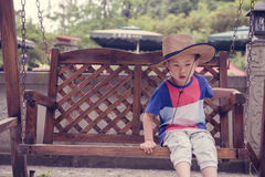 Boy on swing Royalty Free Stock Image