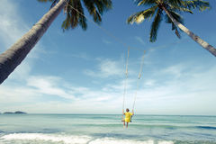 Free Boy Swing In The Sea Royalty Free Stock Images - 56199779