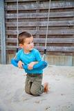 Boy on swing Stock Photos
