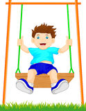 Boy on swing in the park Royalty Free Stock Photos