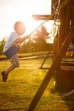 Boy on a swing Stock Photos