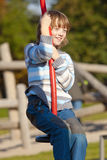 Boy on a Swing in the Playground Royalty Free Stock Photos