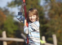 Boy on a Swing in the Playground Stock Photography