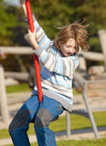 Boy on a Swing in the Playground Royalty Free Stock Photo