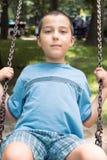 Boy on a swing. Portrait of boy on a swing Royalty Free Stock Photo