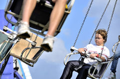 Boy on Swing Ride Royalty Free Stock Image