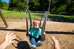 Boy on Swing Set Royalty Free Stock Photography