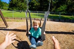 Boy on Swing Set Royalty Free Stock Photography