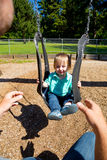 Boy on Swing Set Royalty Free Stock Image