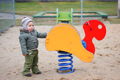 Boy by swing Royalty Free Stock Images