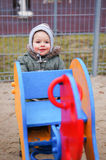 Boy by swing Royalty Free Stock Photography