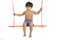 Boy swinging Royalty Free Stock Image
