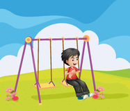 A boy swinging alone Royalty Free Stock Photos
