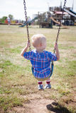 Boy Swinging Stock Image