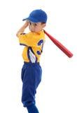 Boy swinging a baseball bat. A young boy swings a baseball bat.  White background Stock Photo