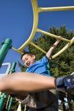 Boy Swinging on Jungle gym - Vertical Stock Photos